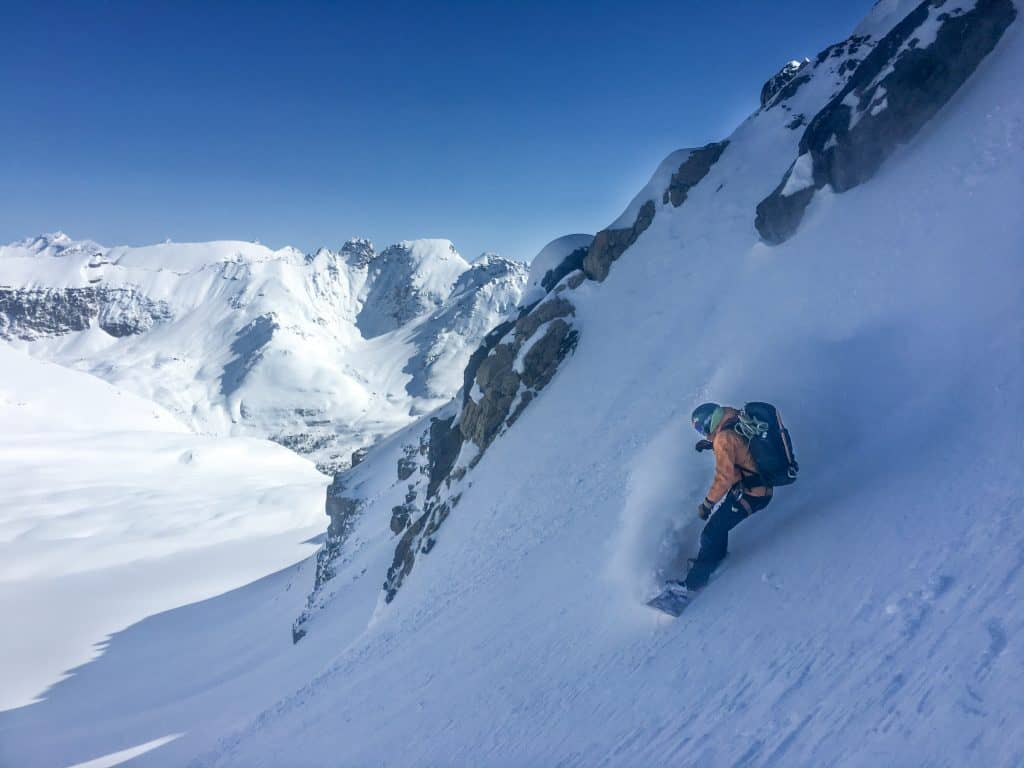 person splitboarding on slope