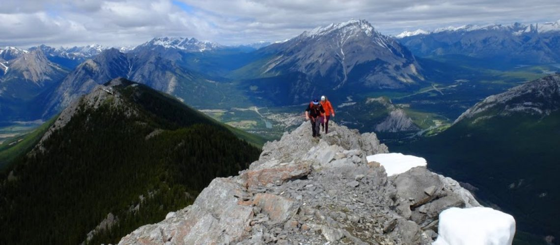 Two people atop a mountain