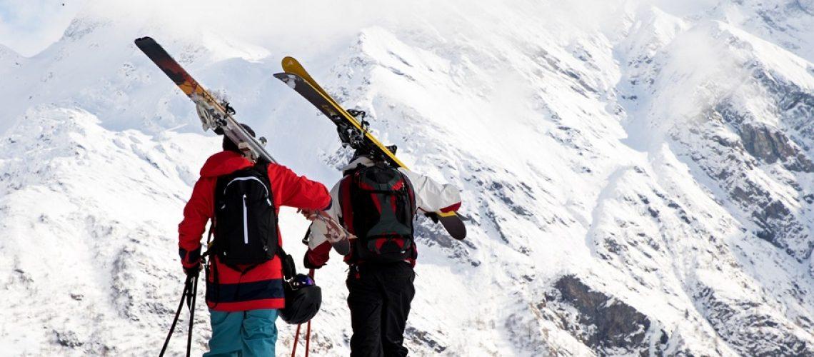 Ski buddies heading up towards big mountain slopes in the heart of Monte Rosa ski area
